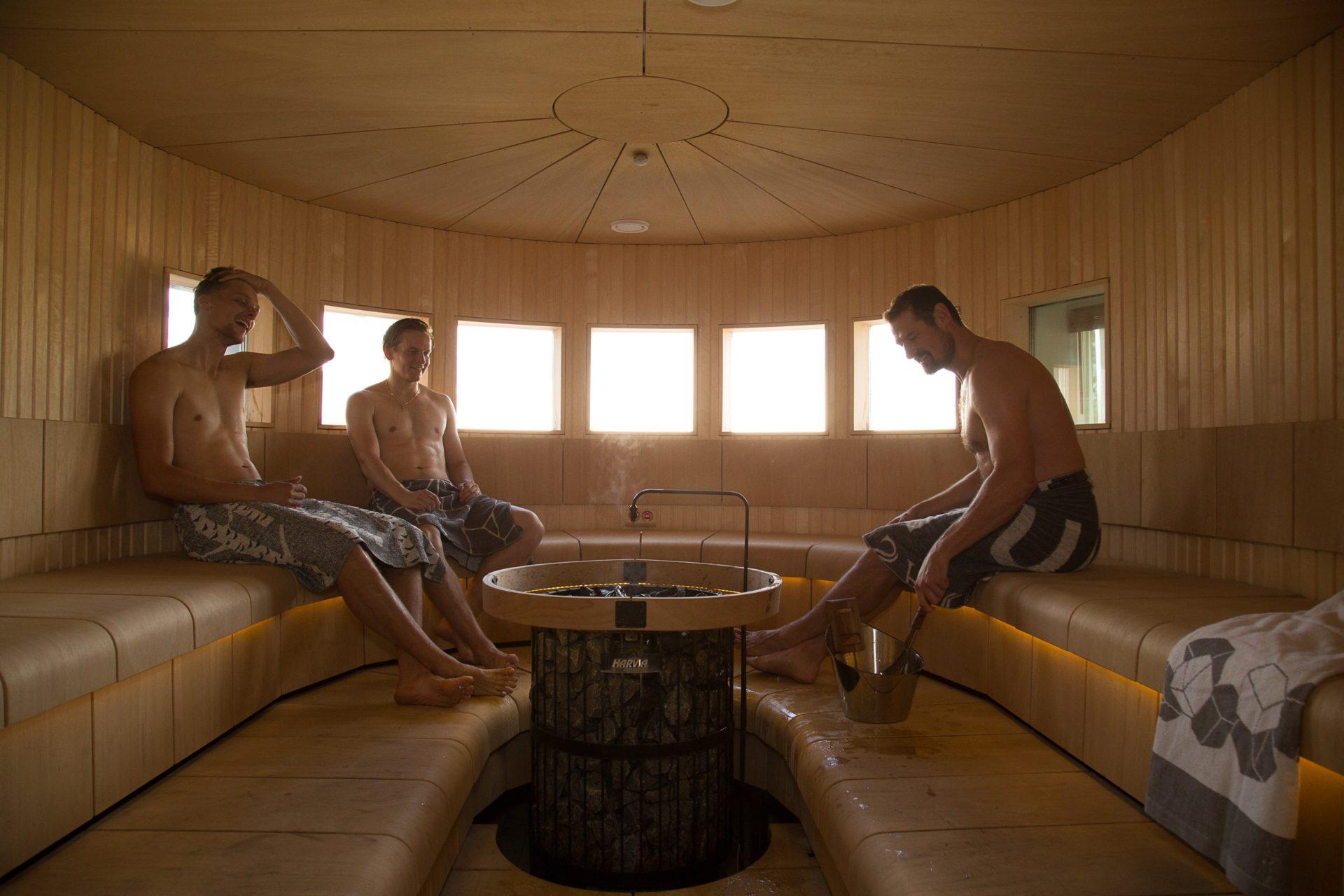 men sitting in harvia sauna